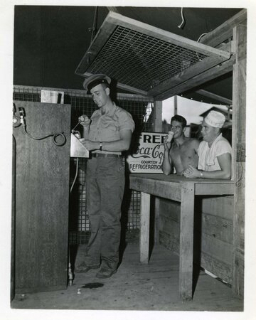 Coke-machine-worked-by-the-refrigeration-crew-for-men-in-64th-Naval-Construction-Battalion-Tub...jpg