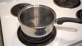 videoblocks-4k-pot-of-water-on-stove-starting-to-boil-with-steam-coming-out_rqvvkubmf_thumbnai...jpg
